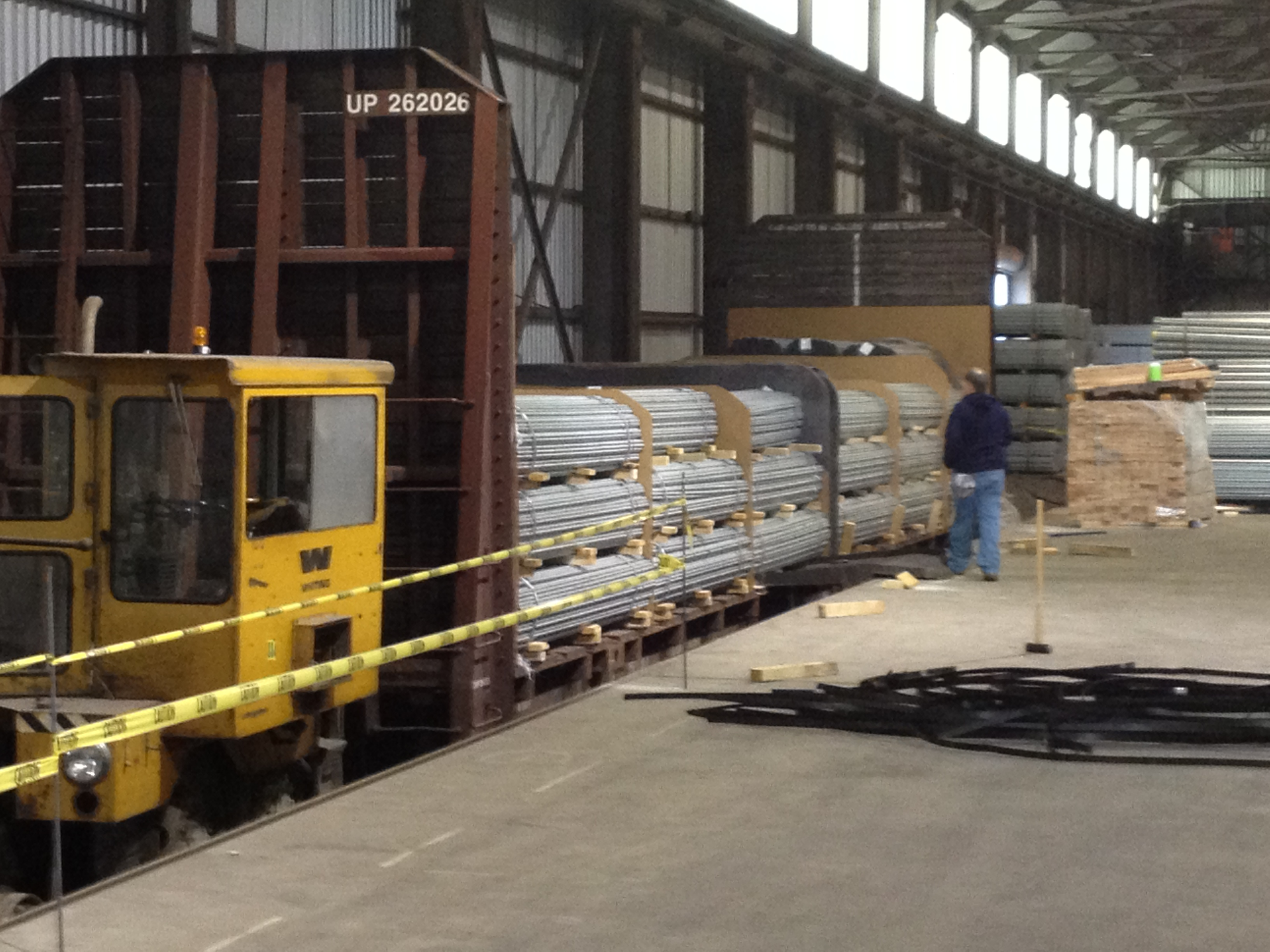 Indoor Rail Reload Siding at the Indianapolis Industrial Center, CSX Gondola being unloaded for regional distribution